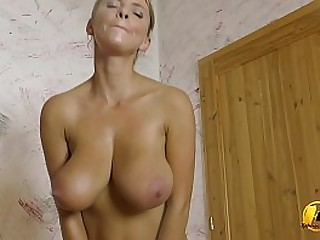 Busty MILF playing all round her huge natural tits and bouncing